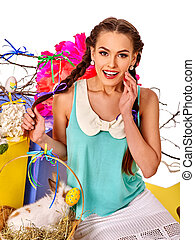 Woman in easter style holding eggs and flowers. - Emotional...