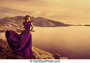 Woman in Elegant Dress on Mountain Coast, Fashion Model in...