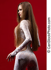 woman in erotic clothing against red wall