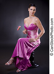 Woman in evening dress - Beautiful young woman sitting on a ...