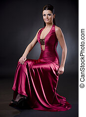 Woman in evening dress - Attractive young woman sitting on a...
