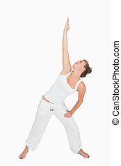 Woman in extended triangle yoga pose - Woman doing extended...