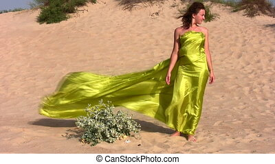 woman in fabric on sand