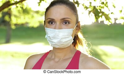 Woman in face mask on nature