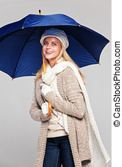 Woman in fall fashion with umbrella