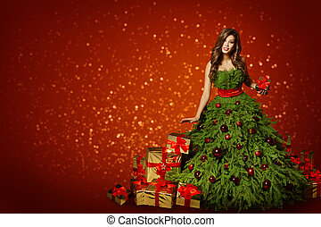 Woman in Fashion Christmas Tree Dress, Girl with Xmas Present Gifts over New Year Red Background