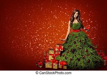 Christmas. beautiful smiling woman. makeup. elegant lady in