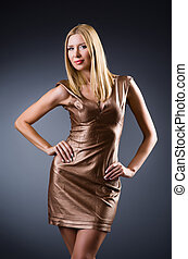 Woman in fashion concept with golden dress