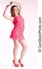 Woman in fashion pink dress