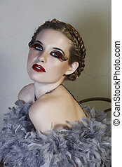 woman in feather boa - blond woman in feather boa with long...