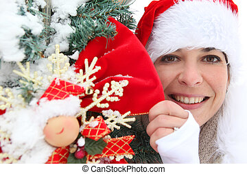 Woman in festive hat holding decorations