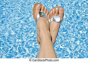 Woman in Flipflops by the Pool