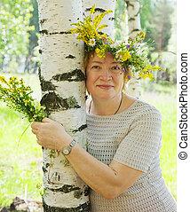woman in flowers wreath