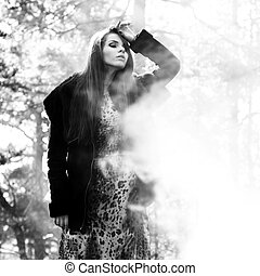 woman in foggy forest