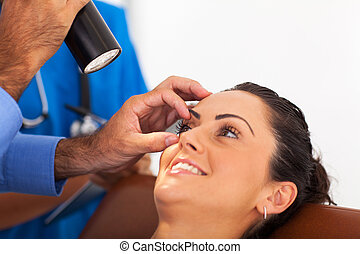 woman in for eye check up in doctor's office