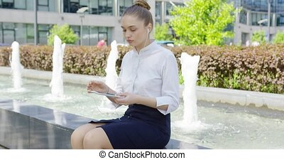 Woman in formal clothing with smartphone