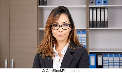 Woman in formal suit smiling at the camera