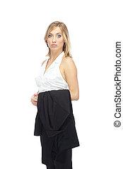 Woman in formal wear - Blond woman in formal wear stands on...