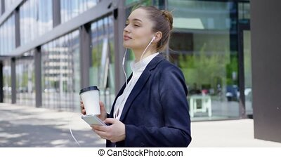Woman in formal with smartphone and coffee - Young confident...