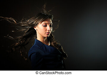 woman in front of a black background