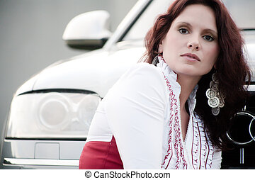 Woman in front of a car