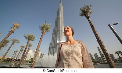 woman in front of fountains near Burj Dubai Lake Hotel in Dubai, UAE