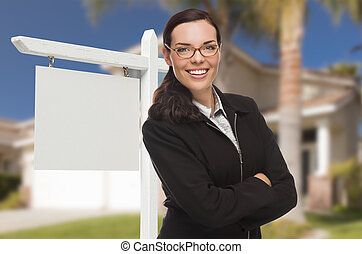 Woman In Front Of House and Blank Real Estate Sign