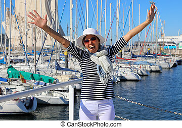 Woman in front of the bay with yachts
