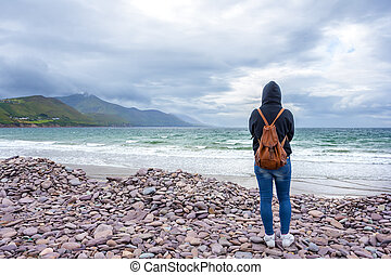 Woman in front of the sea