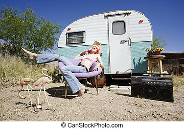 Woman in front of Travel Trailer - Pretty Woman in a Cowboy...