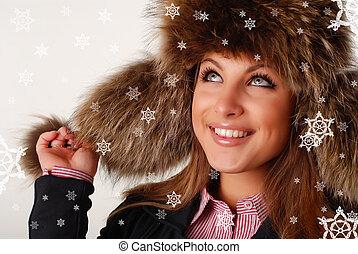 woman in fur cap - beautiful woman in fur cap with ear flaps...
