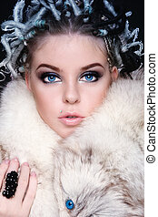 Woman in fur - Beautiful young blue-eyed woman with fancy...