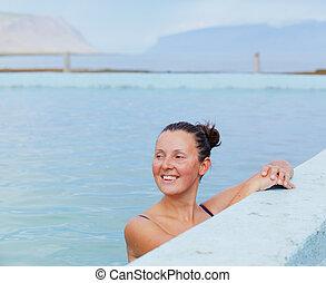 Woman in geothermal spring