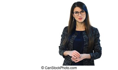 Woman in glasses looking at camera talking