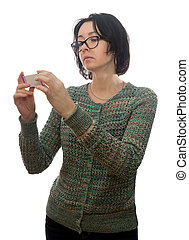 Woman in glasses looks at medicament - Woman of forty years ...