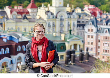 woman in glasses on a background of the city