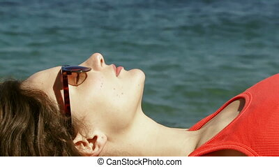 Woman in glasses on the beach