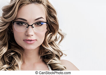 Woman in glasses - Glamorous green eyed blond woman with...