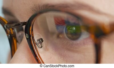 Woman in glasses searching in internet. Close-up. - Close-up...