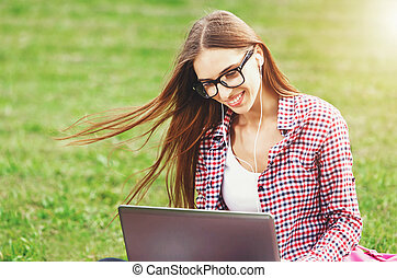 Woman In Glasses Sitting With Laptop