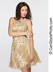 Woman in golden evening dress