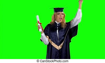 Woman in graduation gown holding diploma. Green screen. Slow motion