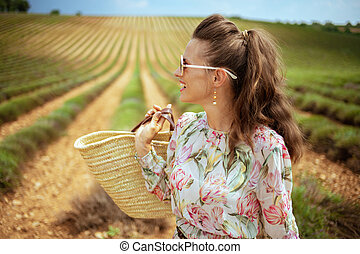 woman in green field in Provence, France looking into distance