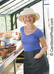 Woman in greenhouse smiling