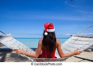 Woman in hammock celebrating Christmas - Woman in hammock on...