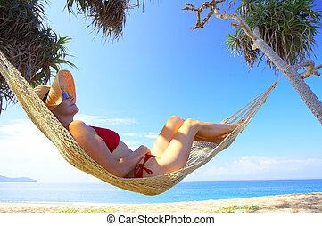 woman in hammock - view of nice woman lounging in hammock in...