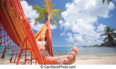 woman in hammock with palmtree audio