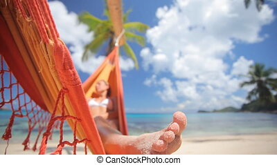 woman in hammock with palmtree audio - woman in hammock...