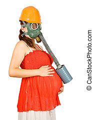 woman in hardhat and gas-mask holding pregnant belly