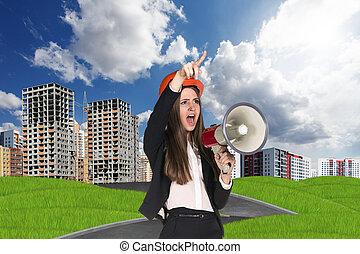 Woman in hardhat screaming in megaphone